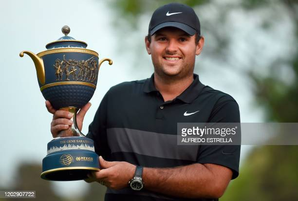 US golfer Patrick Reed holds the trophy after winning the World Golf Championship at Chapultepec's Golf Club in Mexico City on February 23 2020