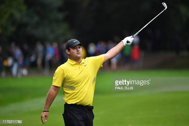 US golfer Patrick Reed indicates a wayward shot on the 17th fairway on Day 4 of the golf PGA Championship at Wentworth Golf Club in Surrey south west...