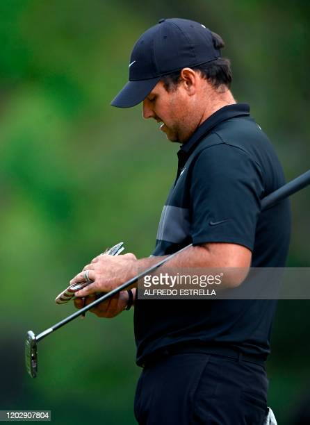 Golfer Patrick Reed lines a putt on the 18th green, during the fourth and last round of the World Golf Championship, at Chapultepec's Golf Club in...
