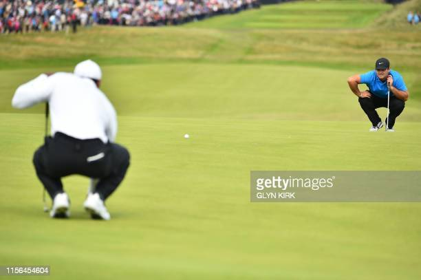 US golfer Patrick Reed lines up a putt on the 1st hole during the second round of the British Open golf Championships at Royal Portrush golf club in...
