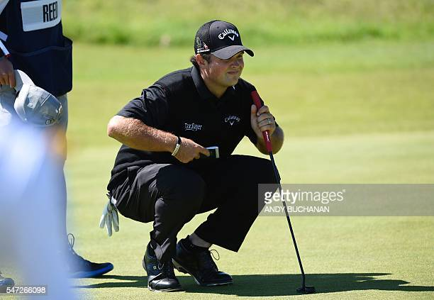 US golfer Patrick Reed lines up his putt on the 15th Green during his first round 66 on the opening day of the 2016 British Open Golf Championship at...