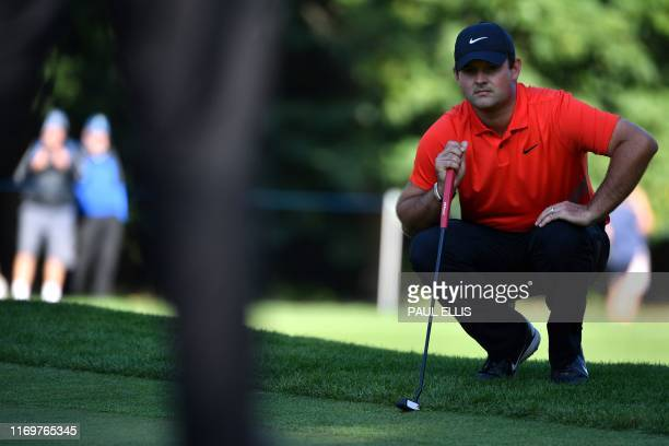 Golfer Patrick Reed lines up his putt on the 3rd green on Day 2 of the golf PGA Championship at Wentworth Golf Club in Surrey, south west of London,...