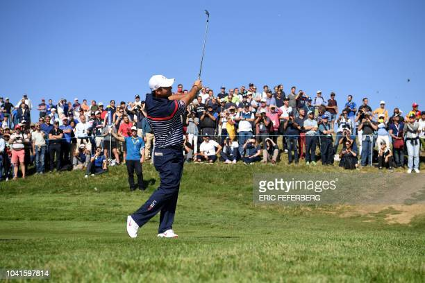 US golfer Patrick Reed plays a fairway shot during a practice session ahead of the 42nd Ryder Cup at Le Golf National Course at...