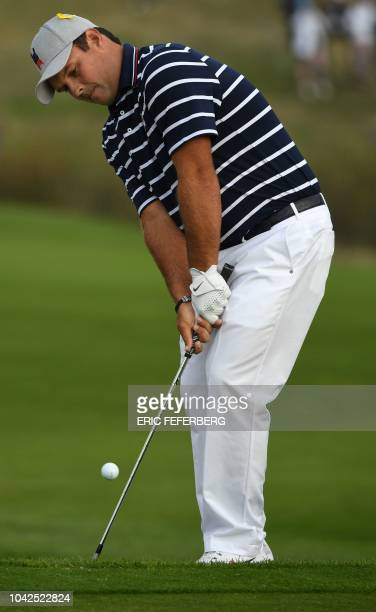 US golfer Patrick Reed plays a fairway shot during his fourball match on the first day of the 42nd Ryder Cup at Le Golf National Course at...
