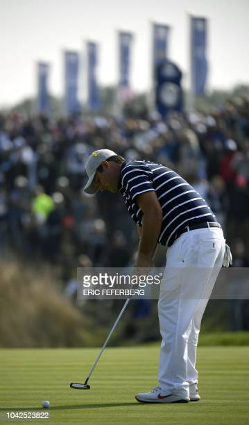 US golfer Patrick Reed plays a putt shot during his fourball match on the first day of the 42nd Ryder Cup at Le Golf National Course at...