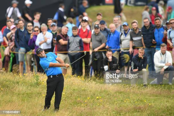 US golfer Patrick Reed plays a shot on the 2nd hole during the second round of the British Open golf Championships at Royal Portrush golf club in...