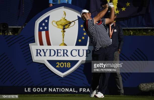 US golfer Patrick Reed plays a tee shot during a practice session ahead of the 42nd Ryder Cup at Le Golf National Course at SaintQuentinenYvelines...