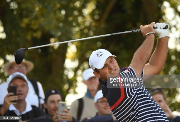 Golfer Patrick Reed plays a tee shot during a practice session ahead of the 42nd Ryder Cup at Le Golf National Course at Saint-Quentin-en-Yvelines,...