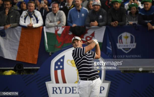 US golfer Patrick Reed plays a tee shot during his fourball match on the first day of the 42nd Ryder Cup at Le Golf National Course at...