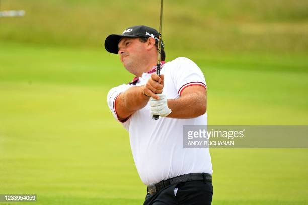 Golfer Patrick Reed plays from green-side bunker during a practice round for The 149th British Open Golf Championship at Royal St George's, Sandwich...