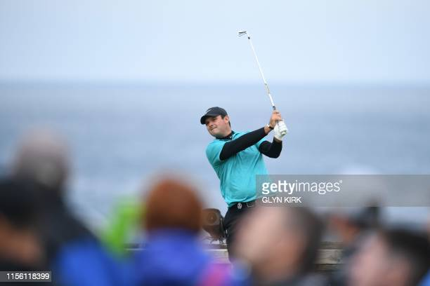 US golfer Patrick Reed plays from the 6th during a practice session at The 148th Open golf Championship at Royal Portrush golf club in Northern...