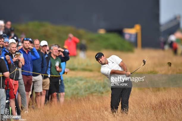 US golfer Patrick Reed plays from the rough on the 7th hole during his second round on day 2 of The 147th Open golf Championship at Carnoustie...