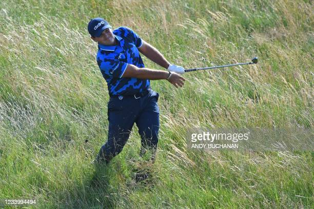 Golfer Patrick Reed plays from the rough on the 7th hole during his first round on day one of The 149th British Open Golf Championship at Royal St...
