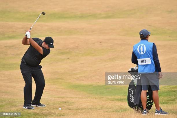US golfer Patrick Reed plays his approach shot during a practice round at The 147th Open golf Championship at Carnoustie Scotland on July 17 2018