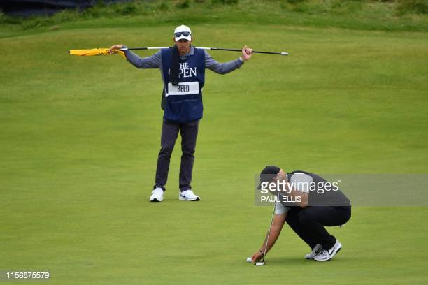 US golfer Patrick Reed prepares to putt at the 17th hole during the third round of the British Open golf Championships at Royal Portrush golf club in...