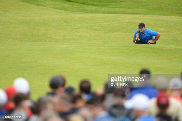 US golfer Patrick Reed prepares to putt on the 2nd hole during the second round of the British Open golf Championships at Royal Portrush golf club in...