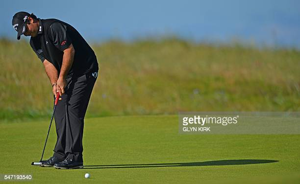 US golfer Patrick Reed putts on the 2nd Green during his first round on the opening day of the 2016 British Open Golf Championship at Royal Troon in...
