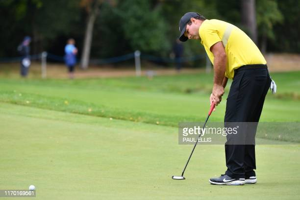US golfer Patrick Reed putts on the 4th green on Day 4 of the golf PGA Championship at Wentworth Golf Club in Surrey south west of London on...
