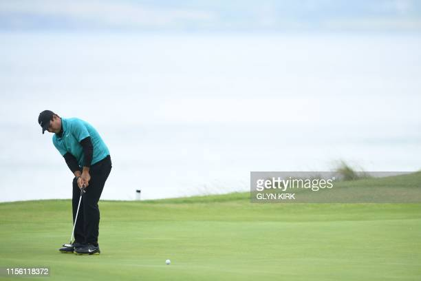US golfer Patrick Reed putts on the 6th during a practice session at The 148th Open golf Championship at Royal Portrush golf club in Northern Ireland...