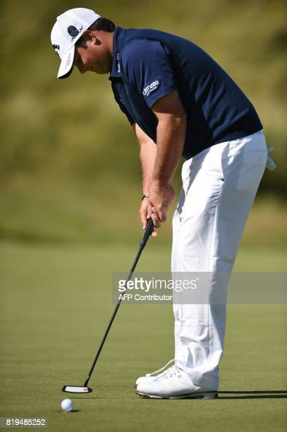 US golfer Patrick Reed putts on the 6th green during his opening round on the first day of the Open Golf Championship at Royal Birkdale golf course...