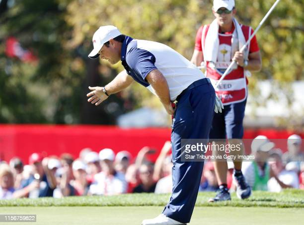 USA golfer Patrick Reed reacts a bow after making a putt 5th to go allsquare with european Rory McIlroy Sunday morning in a match ] JERRY HOLT jerry...