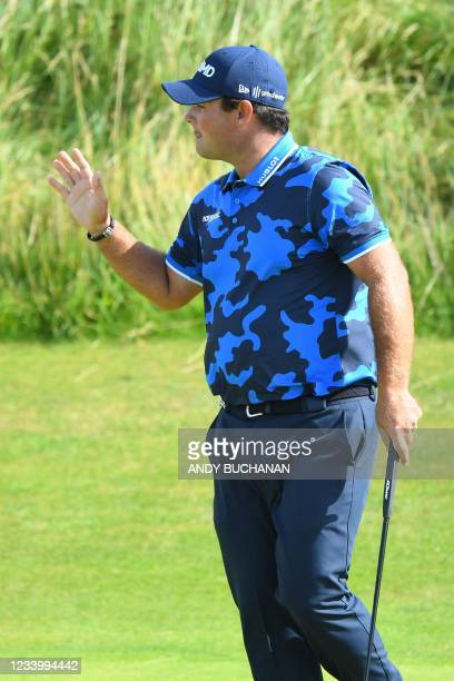 Golfer Patrick Reed reacts after making a long birdie putt on the 6th green during his first round on day one of The 149th British Open Golf...