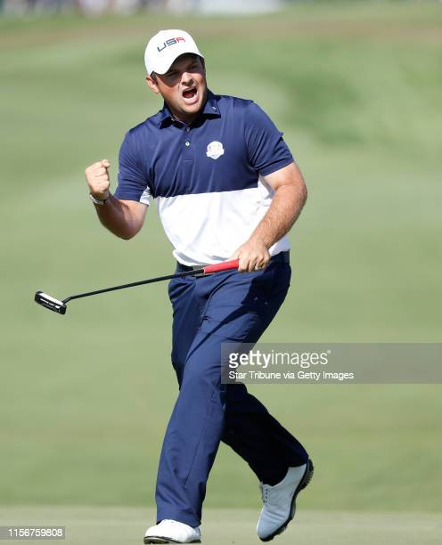 Golfer, Patrick Reed reacts after making a long par put to half the 1st hole with european, Rory McIlroy, Sunday morning in a match. ] JERRY HOLT...