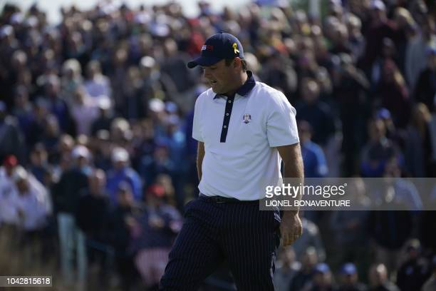 US golfer Patrick Reed reacts during his fourball match on the second day of the 42nd Ryder Cup at Le Golf National Course at SaintQuentinenYvelines...