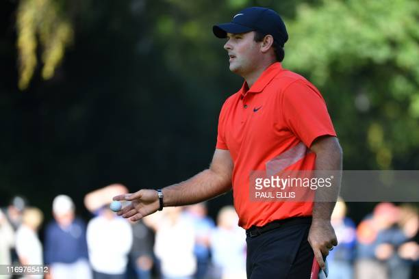 US golfer Patrick Reed reacts on the 3rd green on Day 2 of the golf PGA Championship at Wentworth Golf Club in Surrey south west of London on...