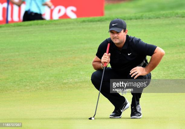 US golfer Patrick Reed reads the green during the DP World Tour Championship at Jumeirah Golf Estates in Dubai on November 21 2019