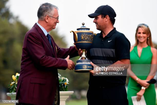 US golfer Patrick Reed receives the trophy from Mexican businessman Ricardo Salinas Pliego after winning the World Golf Championship at Chapultepec's...