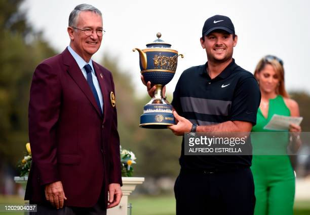 Golfer Patrick Reed receives the trophy from Mexican businessman Ricardo Salinas Pliego after winning the World Golf Championship, at Chapultepec's...
