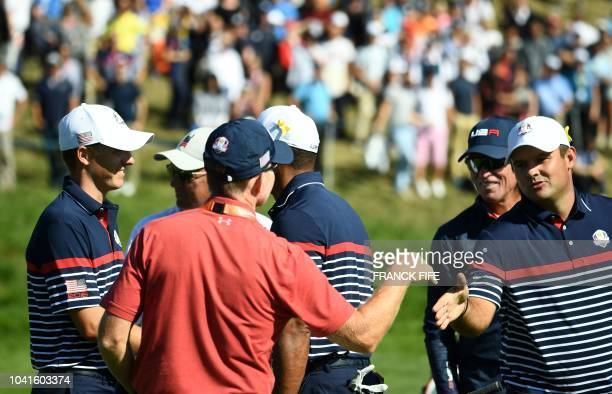 US golfer Patrick Reed shakes hands during a practice session ahead of the 42nd Ryder Cup at Le Golf National Course at SaintQuentinenYvelines...