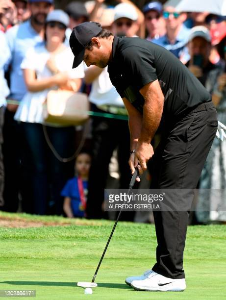US golfer Patrick Reed shoots at the green of 1st during the fourth and last round of the World Golf Championship at Chapultepec's Golf Club in...