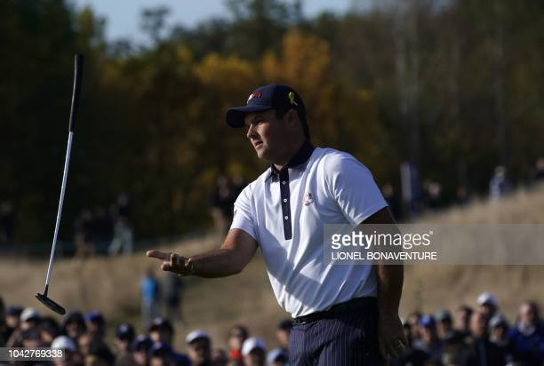 US golfer Patrick Reed throws his club during his fourball match on the second day of the 42nd Ryder Cup at Le Golf National Course at...