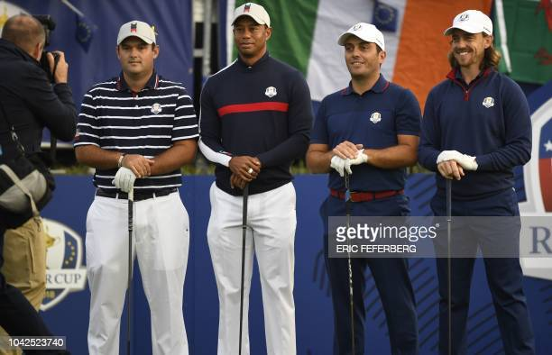 US golfer Patrick Reed US golfer Tiger Woods Europe's Italian golfer Francesco Molinari and Europe's English golfer Tommy Fleetwood pose during their...