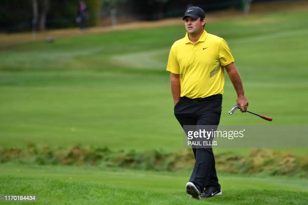 US golfer Patrick Reed walks onto the 4th green on Day 4 of the golf PGA Championship at Wentworth Golf Club in Surrey south west of London on...