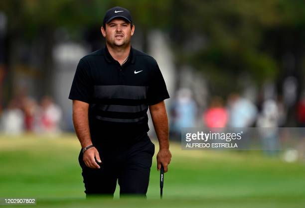 US golfer Patrick Reed walks the fairway to the 18th green during the fourth and last round of the World Golf Championship at Chapultepec's Golf Club...