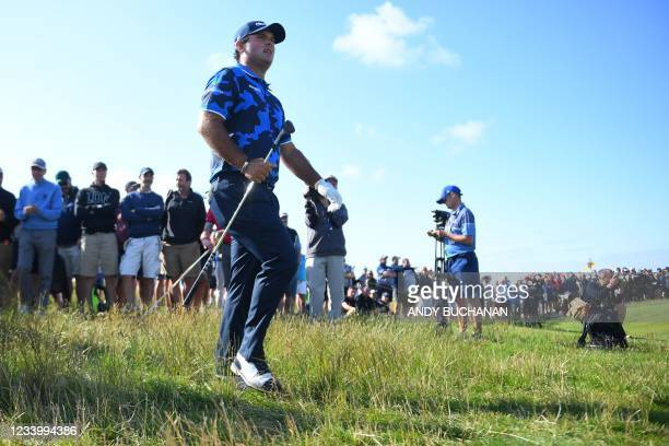 Golfer Patrick Reed walks to the 7th green after playing from the rough during his first round on day one of The 149th British Open Golf Championship...