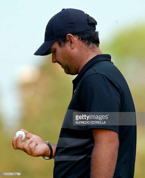 US golfer Patrick Reed watches his ball on the 18th green during the fourth and last round of the World Golf Championship at Chapultepec's Golf Club...