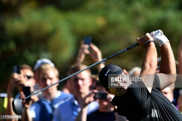 US golfer Patrick Reed watches his drive from the 12th tee on Day 3 of the golf PGA Championship at Wentworth Golf Club in Surrey south west of...