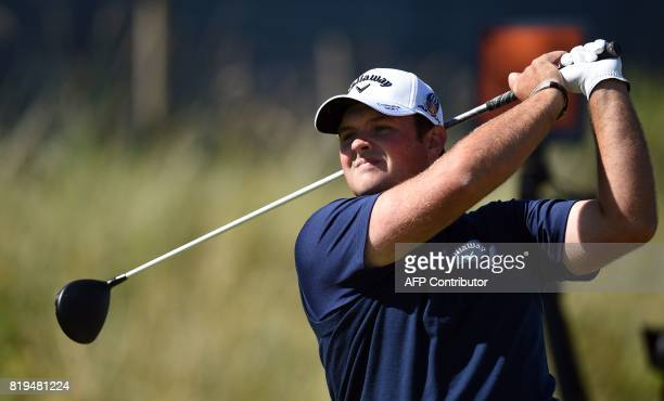 US golfer Patrick Reed watches his drive from the 6th tee during his opening round on the first day of the Open Golf Championship at Royal Birkdale...