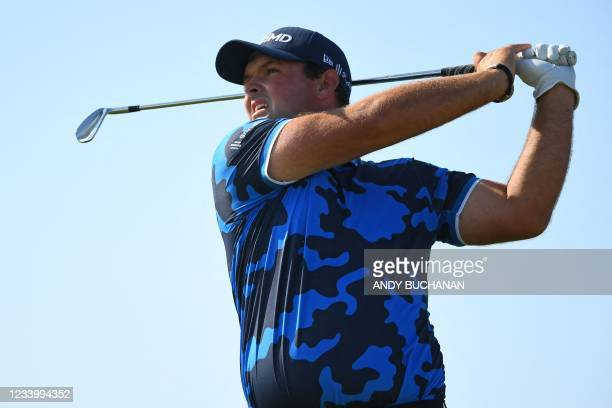 Golfer Patrick Reed watches his iron shot from the 8th tee during his first round on day one of The 149th British Open Golf Championship at Royal St...