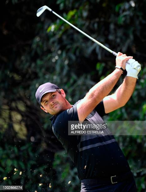 US golfer Patrick Reed watches his tee shot from the 2nd hole during the third round of the World Golf Championship at Chapultepec's Golf Club in...