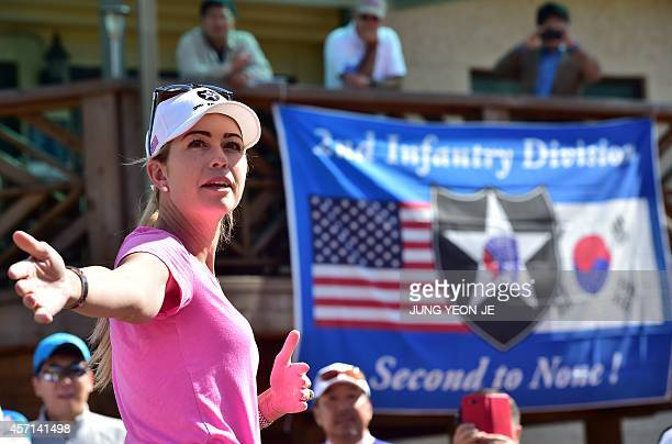 US golfer Paula Creamer attends her golf clinic for US soldiers and neighbors at Camp Red Cloud in Uijeongbu north of Seoul on October 13 2014 Paula...