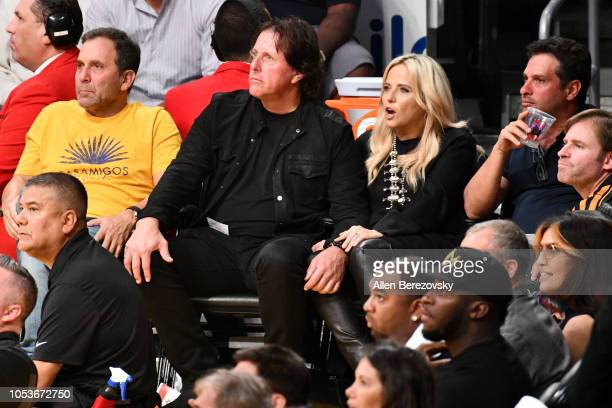 Golfer Phil Mickelson and wife Amy Mickelson attend a basketball game between the Los Angeles Lakers and the Denver Nuggets at Staples Center on...