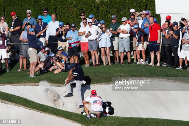USA golfer Phil Mickelson hits out of a sand trap on the 14th hole during the first round of the Presidents Cup on September 28 at Liberty National...