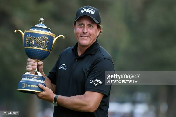 US golfer Phil Mickelson holds his trophy at tee 18 after winning the World Golf Championship in Mexico City on March 4 2018 Fivetime major winner...
