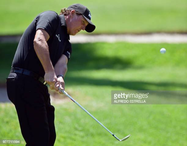 US golfer Phil Mickelson plays his shot at green one during the fourth and last round of the World Golf Championship in Mexico City on March 4 2018 /...