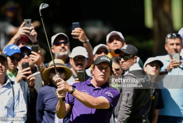 Golfer Phil Mickelson plays his shot on the tenth green, during the first round of the World Golf Championship, in Mexico City on February 21, 2019....